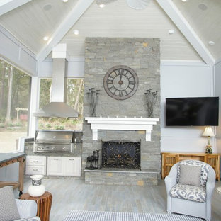 Sunroom - large traditional painted wood floor sunroom idea in Miami with a standard fireplace, a stone fireplace and a standard ceiling