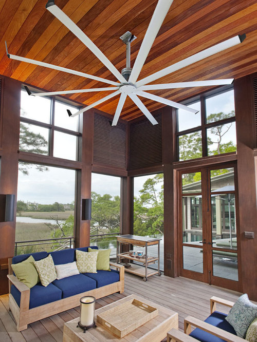 Inspiration For A Contemporary Medium Tone Wood Floor Sunroom Remodel In Louisville With Standard Ceiling