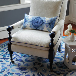 Island Chair - This distinctive plantation-style chair mixes whimsically turned wood legs with crisply tailored upholstery, outlined in piping. The wood legs can be painted in any Benjamin Moore color, for an amazing range of options. To add this level of customization, please contact us via phone 800.818.8288 or chat with us live!