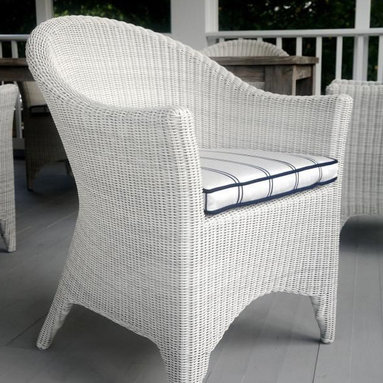 Kingsley-Bate Outdoor Patio and Garden Furniture - An updated rendition of classic wicker furniture, the Cape Cod dining armchair has an elegant, enduring style that is both comfortable and classic. Constructed from premium all-weather wicker and a powder-coated aluminum frame, the chair is equally suited for use indoors or outdoors.