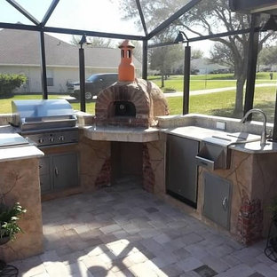 Kitchen with a wood fired oven in a sunroom
