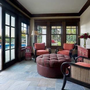 Idée de décoration pour une véranda craftsman avec un plafond standard et un sol gris.