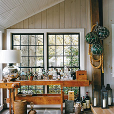 rustic porch by Thom Filicia Inc.