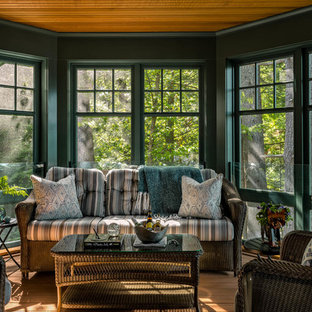 Example of an arts and crafts medium tone wood floor and brown floor sunroom design in Boston with a standard ceiling
