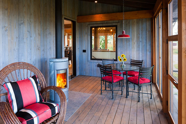 Rustic Sunroom by Dovetail Construction