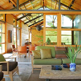 Idéer för ett mellanstort modernt uterum, med betonggolv, en spiselkrans i betong och tak