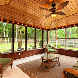Sunroom - large tropical ceramic tile and beige floor sunroom idea in Charleston with a standard ceiling