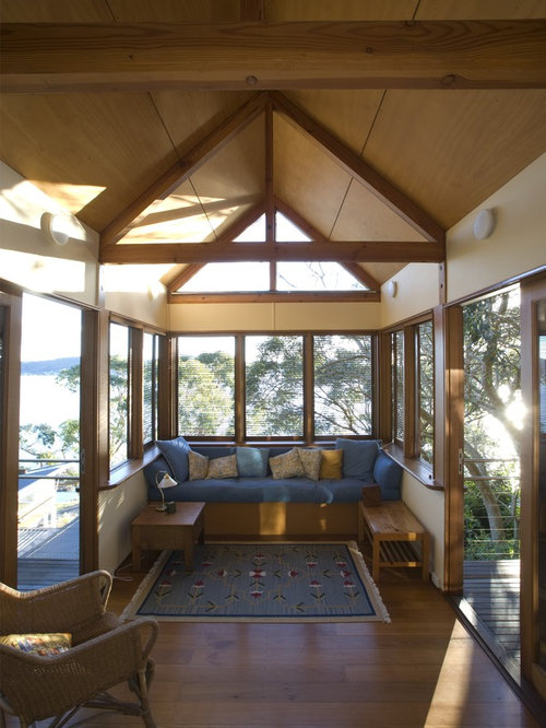 Eclectic Sunroom Sydney Example of a classic sunroom design in Sydney with medium tone hardwood floors and a standard