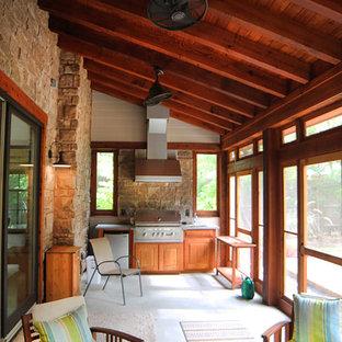 Idéer för ett mellanstort lantligt uterum, med betonggolv och tak