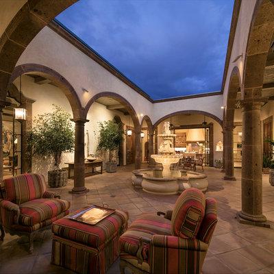 Example of a huge tuscan terra-cotta tile sunroom design in Santa Barbara