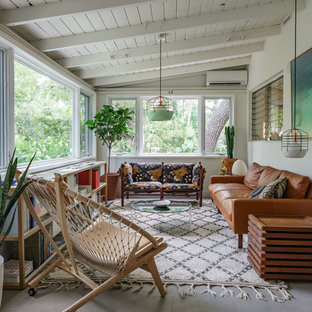 Photo of a midcentury sunroom in Miami.