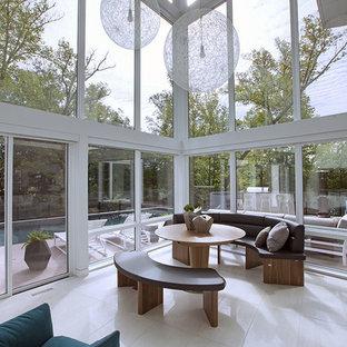 Idee per un'ampia veranda minimal con nessun camino