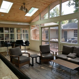 Large trendy ceramic floor and brown floor sunroom photo in Other with a stone fireplace and a skylight