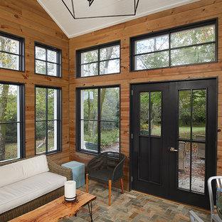 Sunroom - large farmhouse porcelain tile and multicolored floor sunroom idea in Grand Rapids