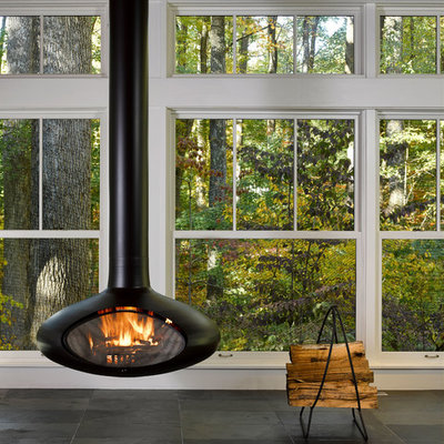 Sunroom - mid-sized modern slate floor sunroom idea in Baltimore with a hanging fireplace and a standard ceiling