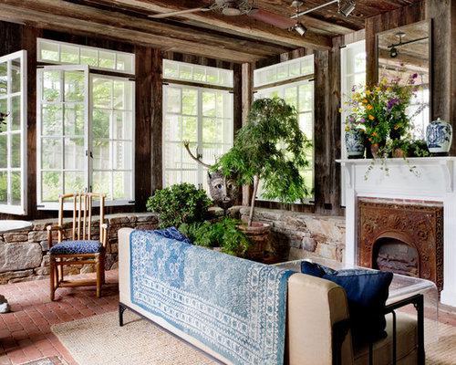 v randas avec une chemin e standard et un sol en brique photos et id es d co de v randas. Black Bedroom Furniture Sets. Home Design Ideas