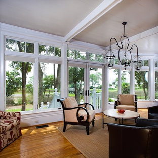 Sunroom - large coastal light wood floor and white floor sunroom idea in Atlanta with no fireplace and a standard ceiling
