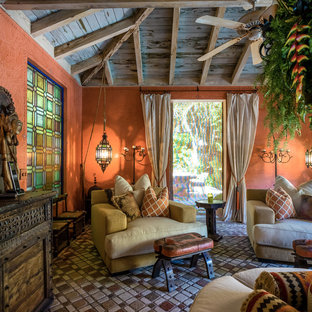 Design ideas for a large mediterranean conservatory in Miami with terracotta flooring, a standard ceiling and brown floors.