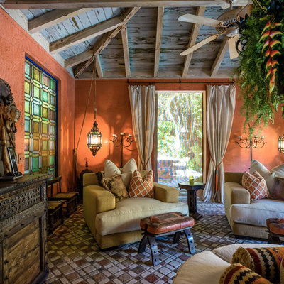Large tuscan terra-cotta tile and brown floor sunroom photo in Miami with a standard ceiling