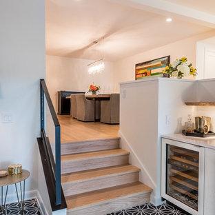 Natural Oak Floor/Stairs Meets Cement Tile Sun Room Floor