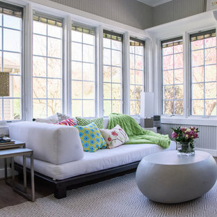 Photo of a large bohemian conservatory in Philadelphia with laminate floors, a standard ceiling and brown floors.