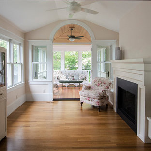 Example of a mid-sized ornate light wood floor sunroom design in Detroit with a standard fireplace, a standard ceiling and a tile fireplace