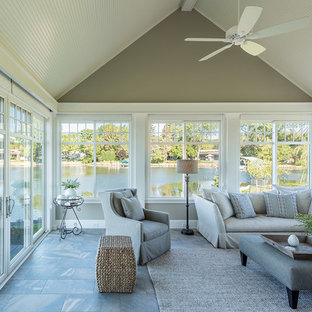Inspiration for a large timeless ceramic tile and gray floor sunroom remodel in Minneapolis with no fireplace and a standard ceiling