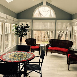 This is an example of a large traditional conservatory in San Diego with laminate floors, no fireplace, a skylight and grey floors.