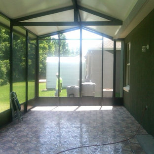 Large contemporary conservatory in Orlando with laminate floors, no fireplace and a standard ceiling.