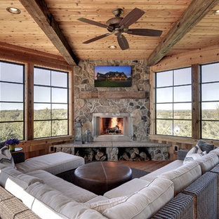 Large rustic conservatory in Louisville with medium hardwood flooring, a corner fireplace, a stone fireplace surround, a standard ceiling and brown floors.