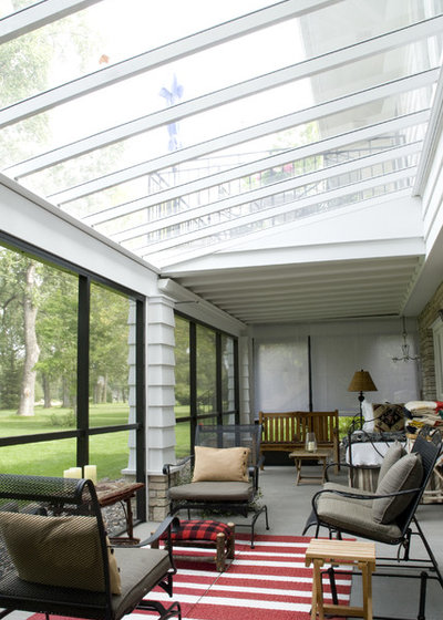 Traditional Sunroom by JP&CO