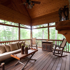 Rustic Deck by Hillcrest Home of Keowee Inc.