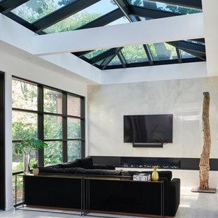 Idéer för ett stort eklektiskt uterum, med ljust trägolv och takfönster