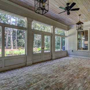 Design ideas for a large traditional conservatory in Atlanta with brick flooring, no fireplace, a standard ceiling and brown floors.