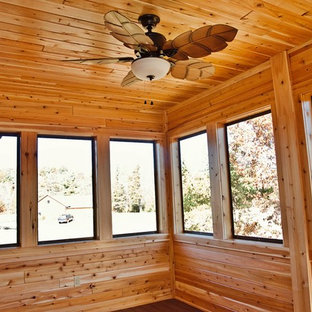Sunroom - mid-sized craftsman medium tone wood floor and brown floor sunroom idea in Other with no fireplace and a standard ceiling