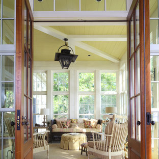 Inspiration for a coastal yellow floor sunroom remodel in Other with a standard ceiling