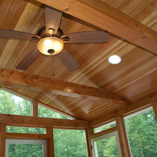 Example of a mid-sized classic medium tone wood floor sunroom design in Manchester with no fireplace and a standard ceiling