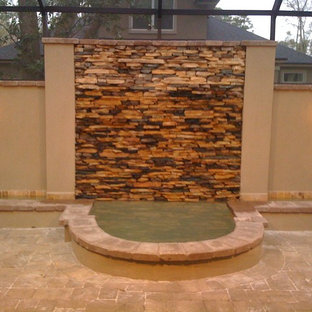 Privacy wall with natural pond