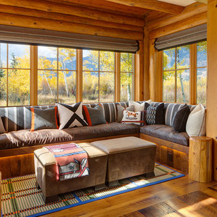 Example of a small mountain style medium tone wood floor sunroom design in Other with no fireplace and a standard ceiling