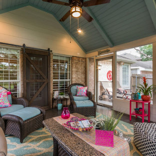 Example of a mid-sized classic concrete floor sunroom design in Dallas with no fireplace and a standard ceiling