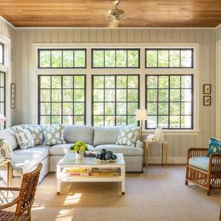 Foto de galería costera, de tamaño medio, sin chimenea, con moqueta, techo estándar y suelo beige