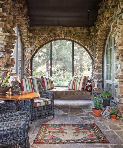 Rustic Sunroom by Goddard Design Group