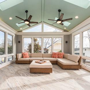 Foto de galería clásica renovada, grande, sin chimenea, con suelo de baldosas de cerámica, techo con claraboya y suelo gris