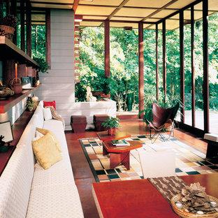 Idée de décoration pour une véranda vintage de taille moyenne avec béton au sol, aucune cheminée et un plafond standard.