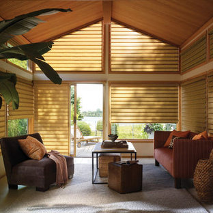 Example of an island style sunroom design in Detroit