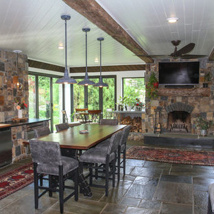 Example of a large arts and crafts limestone floor and multicolored floor sunroom design in Other with a standard fireplace and a stone fireplace