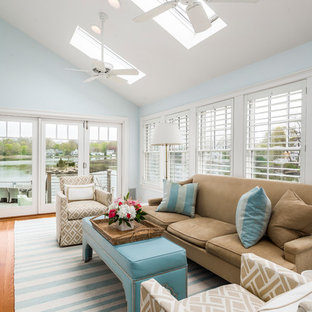 Beach style medium tone wood floor sunroom photo in New York with no fireplace and a skylight