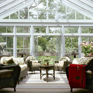 Photo of a large farmhouse conservatory in New York with no fireplace, a glass ceiling, slate flooring and multi-coloured floors.