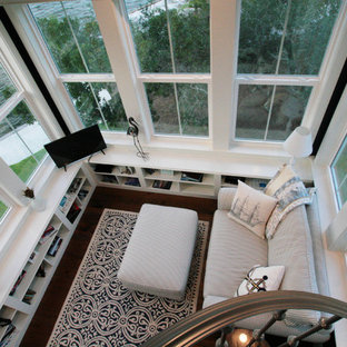 Example of a large beach style dark wood floor sunroom design with no fireplace and a standard ceiling
