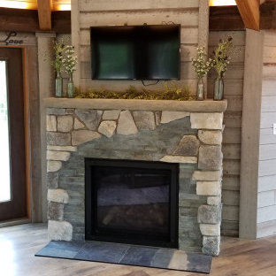 Example of a mountain style vinyl floor and brown floor sunroom design in Grand Rapids with a standard fireplace and a tile fireplace